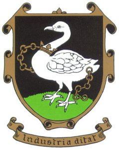 "The crest of the town of High Wycombe shows a white swan on a green and black background with the words ""Industria ditat"""
